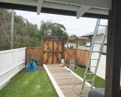 (During)Prepping and painting the new timber fences